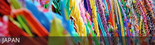 Thousands of origami cranes with text overlay: Japan