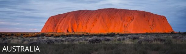 Sunset over uluru with text overlay: Australia