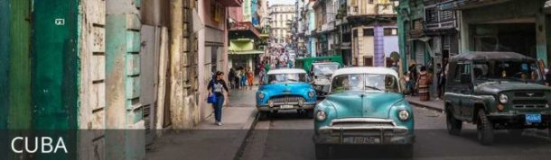 Old cars driving the streets of Havana in Cuba with text overlay: Cuba