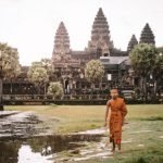 Angkor wat with buddhist in front Backpacking Cambodia Itinerary