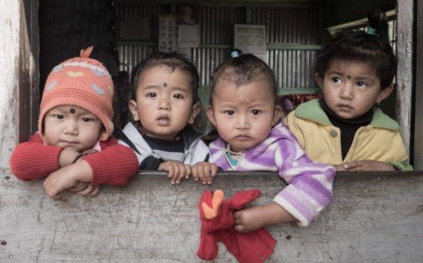 Children in Darjeeling - How to save money for long-term travel