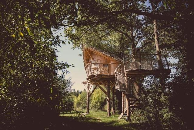 """La Chouette Cabane in Pommerieux France - Dreaming of a treehouse holiday in Europe? Want to get in touch with your childlike wonder again? This is a seriously impressive list of the most romantic treehouse hotels in Europe to help you plan your next """"glamping"""" luxury getaway"""