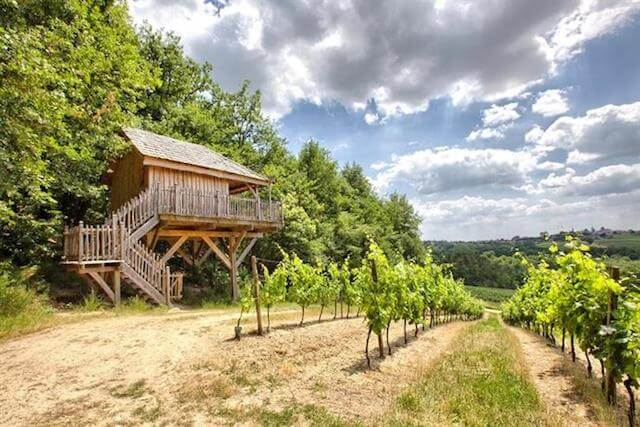"""Les Cabanes des Benauges France - Dreaming of a treehouse holiday in Europe? Want to get in touch with your childlike wonder again? This is a seriously impressive list of the most romantic treehouse hotels in Europe to help you plan your next """"glamping"""" luxury getaway"""