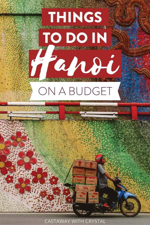 """Man rides motorbike next to colourful wall with text olay: """"Things to do in Hanoi on a budget"""""""