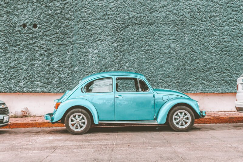 A parked aqua beetle car - Driving in Mexico Road Trip