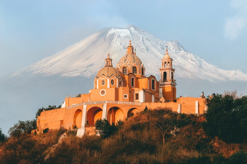 Church and mountain of Puebla - Driving in Mexico Road Trip