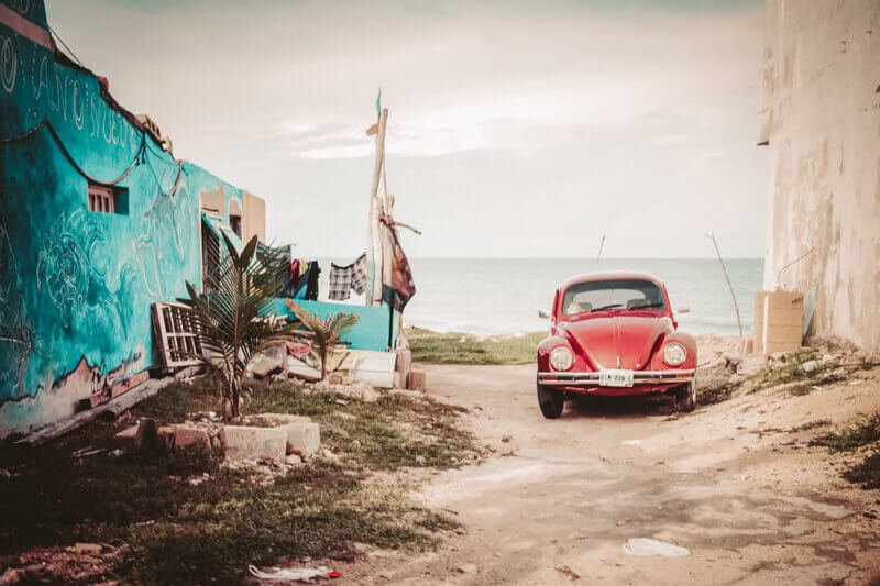 A beetle car in front of the beach - Driving in Mexico Road Trip