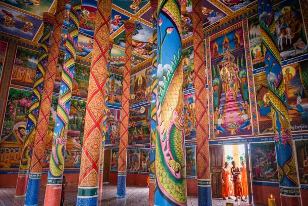 Inside Toek Vil Pagoda with monks for Backpacking Cambodia Itinerary