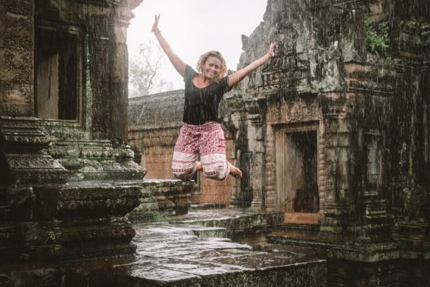 Dancing in the rain at Angkor Wat for Backpacking Cambodia Itinerary