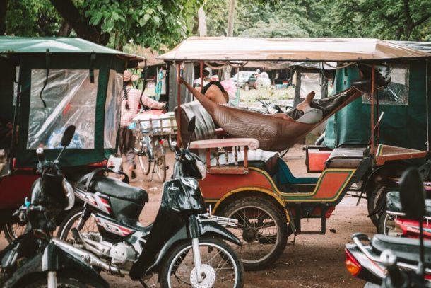Our Tuk Tuk driver sleeps in his vehicle for Backpacking Cambodia Itinerary