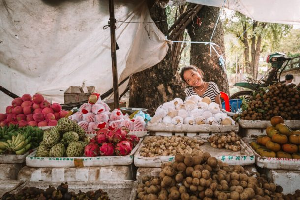 Girl sells fruits and vegetables in Siem Reap for Backpacking Cambodia Itinerary