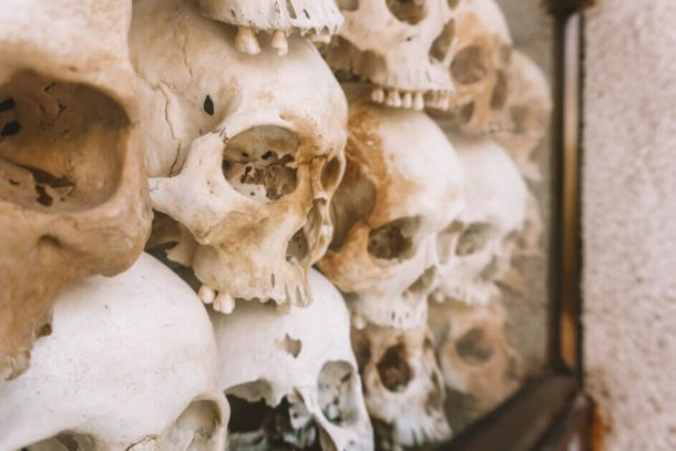 Skulls in a box at the Killing Fields for backpacking guide to Cambodia