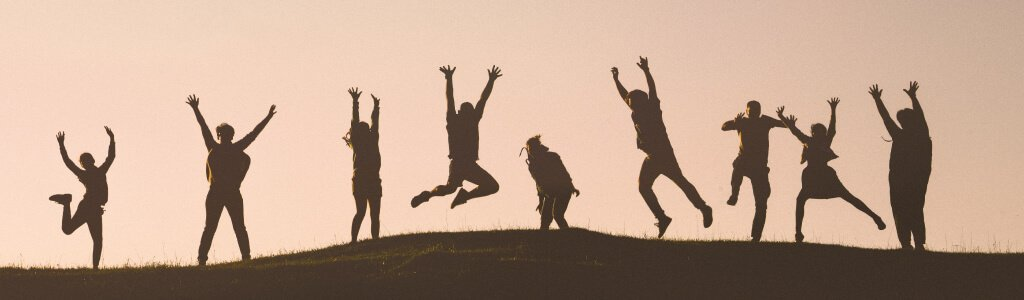 People jumping for joy at the thought of exclusive travel deals