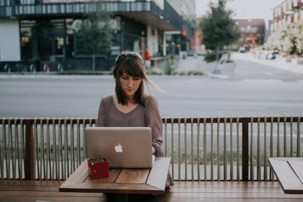 Woman at computer for How to Stay Safe from Cybercrime When You Travel