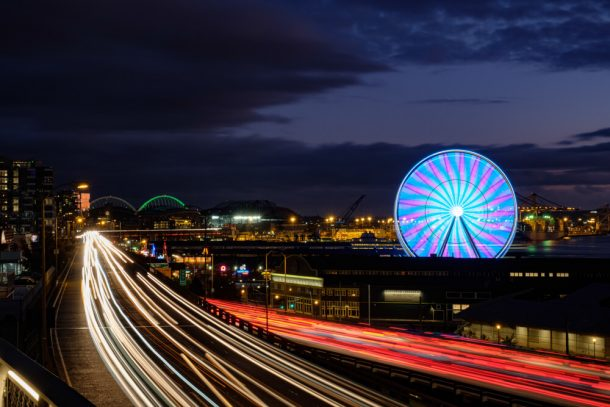 Busy road and Seattle Ferris wheel at night for 3 days in Seattle itinerary