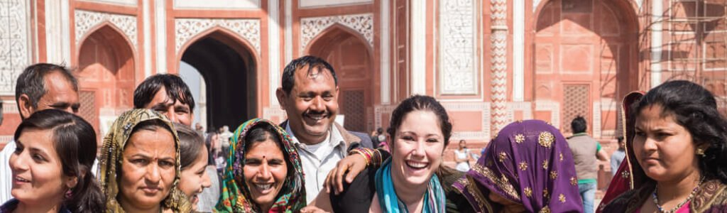 Indian people in front of temple for post: Planning a trip to India on a budget