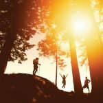Best Hiking Gifts Cover Pic with people jumping at sunset