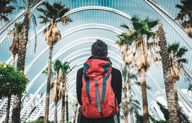 Backpacker admires view for best backpacking gifts