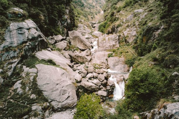 The Big Waterfall splashes over rocks between a valley for Best places to visit in Dharamshala and McLeodganj