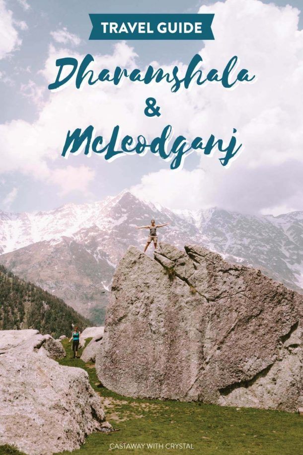 """Tiny woman standing on top of a huge boulder with snowy mountains in the background with text olay: """"Travel Guide Dharamshala & McLeodganj)"""