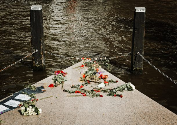 Homomonument with flowers for unusual things to do in Amsterdam